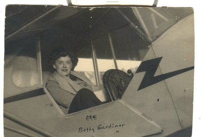 Elizabeth 'Bets' Gardiner in the rear seat of a Cub   at Stormville in 1943.  On the back, 'Learning to fly at Stormville Airport.'